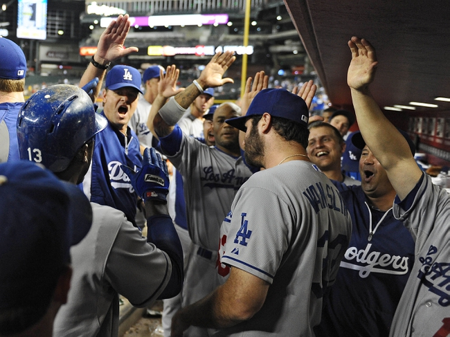 Jul 10, 2013; Phoenix, AZ, USA;  Los Angeles Dodgers infielder Hanley Ramirez (13) is congratulated after hitting a solo home run against the Arizona Diamondbacks in the 14th inning at Chase Field. Mandatory Credit: Jennifer Stewart-USA TODAY Sports