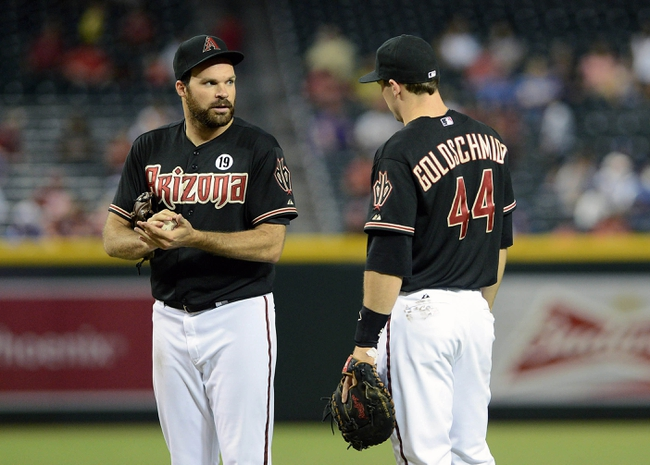 Jul 10, 2013; Phoenix, AZ, USA;  Arizona Diamondbacks pitcher Josh Collmenter (55) talks with infielder Paul Goldschmidt (44) during the game against the Los Angeles Dodgers at Chase Field. The Dodgers defeated the Diamondbacks 7-5 in extra innings.  Mandatory Credit: Jennifer Stewart-USA TODAY Sports
