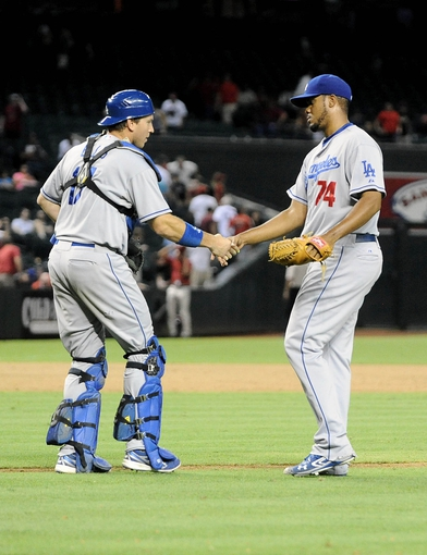 Jul 10, 2013; Phoenix, AZ, USA;  Los Angeles Dodgers pitcher Paco Rodriguez (75) is congratulated by catcher A.J. Ellis (17) after defeating the Arizona Diamondbacks in the 14th inning at Chase Field. The Dodgers defeated the Diamondbacks 7-5 in extra innings. Mandatory Credit: Jennifer Stewart-USA TODAY Sports