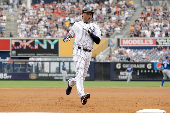 Jul 11, 2013; Bronx, NY, USA; New York Yankees designated hitter Derek Jeter (2) advances to third base against the Kansas City Royals during the first inning of a game at Yankee Stadium. Mandatory Credit: Brad Penner-USA TODAY Sports