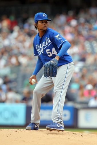 Jul 11, 2013; Bronx, NY, USA; Kansas City Royals starting pitcher Ervin Santana (54) pitches against the New York Yankees during the first inning of a game at Yankee Stadium. Mandatory Credit: Brad Penner-USA TODAY Sports