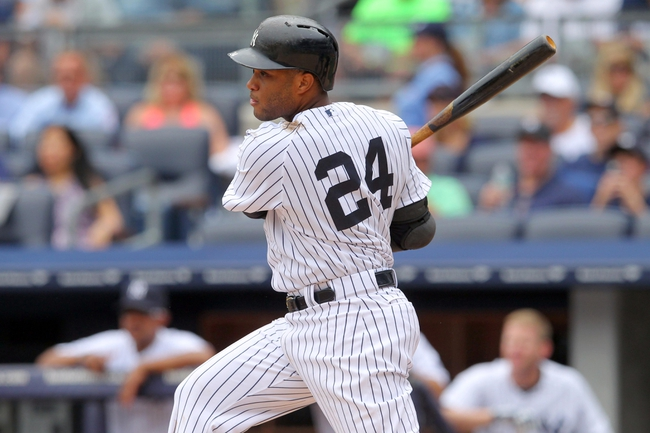 Jul 11, 2013; Bronx, NY, USA; New York Yankees second baseman Robinson Cano (24) hits a single against the Kansas City Royals during the first inning of a game at Yankee Stadium. Mandatory Credit: Brad Penner-USA TODAY Sports