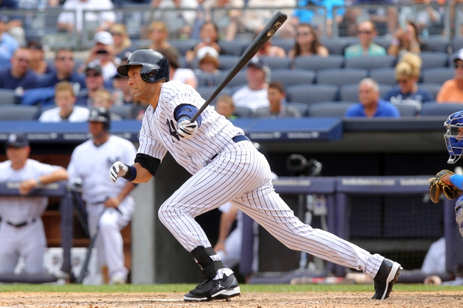Jul 11, 2013; Bronx, NY, USA; New York Yankees designated hitter Derek Jeter (2) hits an RBI ground out against the Kansas City Royals during the sixth inning of a game at Yankee Stadium. Mandatory Credit: Brad Penner-USA TODAY Sports