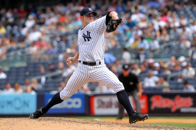 Jul 11, 2013; Bronx, NY, USA; New York Yankees relief pitcher David Robertson (30) pitches against the Kansas City Royals during the eighth inning of a game at Yankee Stadium. Mandatory Credit: Brad Penner-USA TODAY Sports