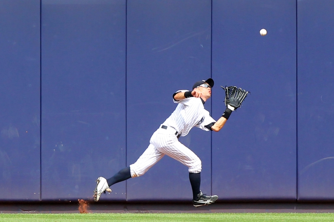 Jul 11, 2013; Bronx, NY, USA; New York Yankees center fielder Ichiro Suzuki (31) catches a ball hit by Kansas City Royals designated hitter Billy Butler (not pictured) to end the game at Yankee Stadium. Mandatory Credit: Brad Penner-USA TODAY Sports