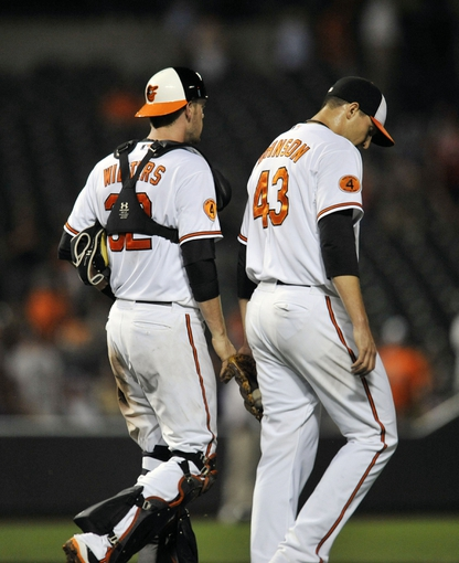 Jul 11, 2013; Baltimore, MD, USA; Baltimore Orioles catcher Matt Wieters (32) and closer Jim Johnson (43) after a game against the Texas Rangers at Oriole Park at Camden Yards. The Orioles defeated the Rangers 3-1. Mandatory Credit: Joy R. Absalon-USA TODAY Sports