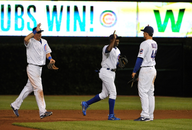Jul 11, 2013; Chicago, IL, USA; Chicago Cubs right fielder Brian Bogusevic (L)  left fielder Alfonso Soriano (12) and first baseman Anthony Rizzo (44) celebrate the Cubs win against the St. Louis Cardinals at Wrigley Field. The Chicago Cubs defeated the St. Louis Cardinals 3-0. Mandatory Credit: David Banks-USA TODAY Sports