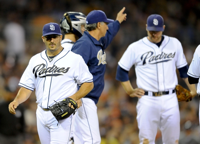Jul 11, 2013; San Diego, CA, USA; San Diego Padres starting pitcher Jason Marquis (21) is taken out of the game by manager Bud Black (jacket) during the sixth inning against the San Francisco Giants at Petco Park. Mandatory Credit: Christopher Hanewinckel-USA TODAY Sports