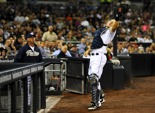 Jul 11, 2013; San Diego, CA, USA; San Diego Padres catcher Nick Hundley (4) catches a foul ball in front of his dugout during the fifth inning against the San Francisco Giants at Petco Park. Mandatory Credit: Christopher Hanewinckel-USA TODAY Sports