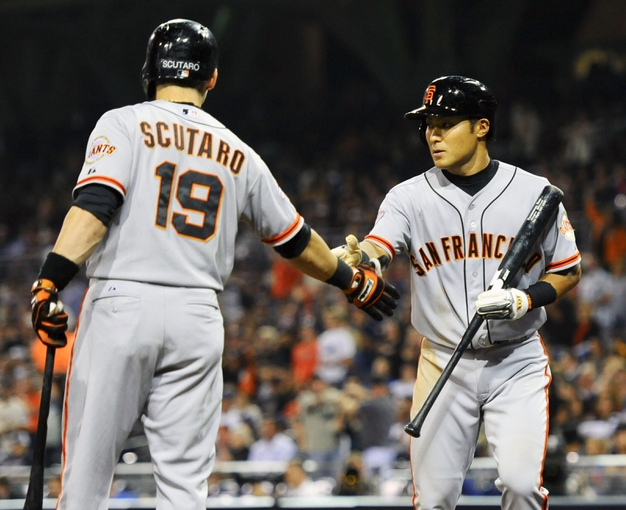 Jul 11, 2013; San Diego, CA, USA; San Francisco Giants left fielder Kensuke Tanaka (37) is congratulated by second baseman Marco Scutaro (19) after scoring during the eighth inning against the San Diego Padres at Petco Park. Mandatory Credit: Christopher Hanewinckel-USA TODAY Sports