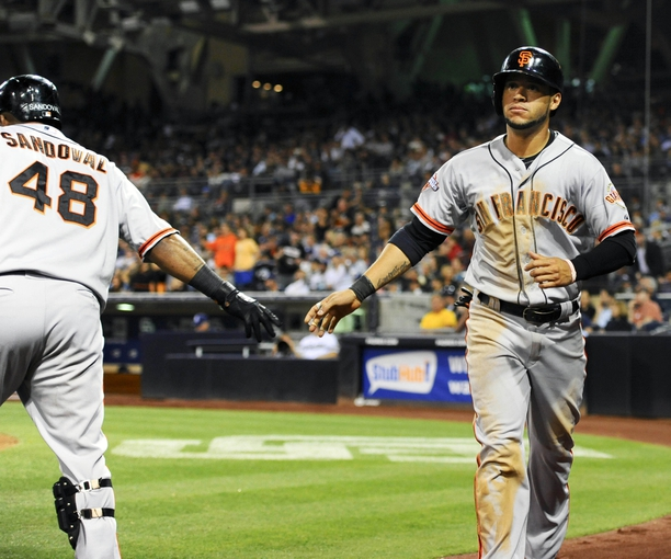 Jul 11, 2013; San Diego, CA, USA; San Francisco Giants center fielder Gregor Blanco (7) is congratulated by third baseman Pablo Sandoval (48) after scoring on a single by catcher Buster Posey (not pictured) during the eighth inning against the San Diego Padres at Petco Park. Mandatory Credit: Christopher Hanewinckel-USA TODAY Sports