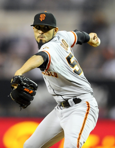 Jul 11, 2013; San Diego, CA, USA; San Francisco Giants relief pitcher Sergio Romo (54) throws during the ninth inning against the San Diego Padres at Petco Park. Mandatory Credit: Christopher Hanewinckel-USA TODAY Sports