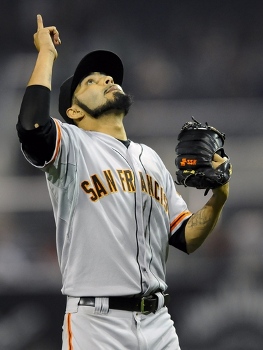 Jul 11, 2013; San Diego, CA, USA; San Francisco Giants relief pitcher Sergio Romo (54) celebrates after a 4-2 win against the San Diego Padres at Petco Park. Mandatory Credit: Christopher Hanewinckel-USA TODAY Sports