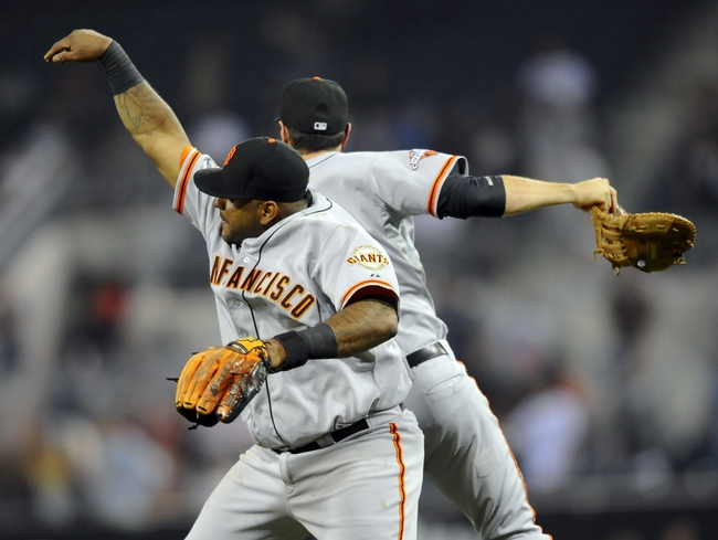 Jul 11, 2013; San Diego, CA, USA; San Francisco Giants third baseman Pablo Sandoval (48) celebrates with first baseman Brandon Belt (9) after a 4-2 win against the San Diego Padres at Petco Park. Mandatory Credit: Christopher Hanewinckel-USA TODAY Sports
