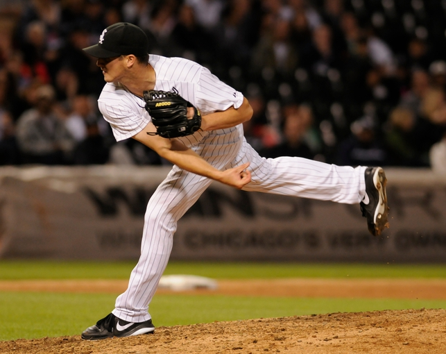 Jul 2, 2013; Chicago, IL, USA; Chicago White Sox relief pitcher Nate Jones (65) delivers a pitch during the game against the Baltimore Orioles at U.S. Cellular Field. White Sox defeated the Orioles 5-2. Mandatory Credit: Reid Compton-USA TODAY Sports