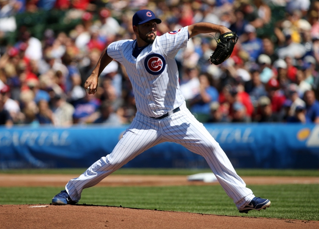 Jul 12, 2013; Chicago, IL, USA; Chicago Cubs pitcher Carlos Villanueva throws a pitch against the St. Louis Cardinals during the first inning at Wrigley Field. Mandatory Credit: Jerry Lai-USA TODAY Sports
