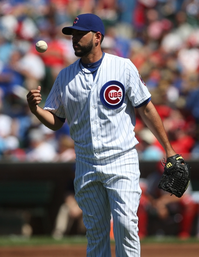 Jul 12, 2013; Chicago, IL, USA; Chicago Cubs pitcher Carlos Villanueva reacts after giving up a run to the St. Louis Cardinals during the first inning at Wrigley Field. Mandatory Credit: Jerry Lai-USA TODAY Sports