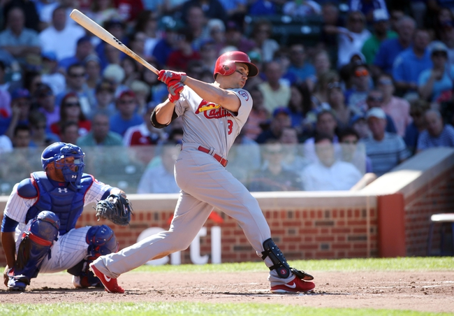 Jul 12, 2013; Chicago, IL, USA; St. Louis Cardinals right fielder Carlos Beltran hits a single against the Chicago Cubs during the third inning at Wrigley Field. Mandatory Credit: Jerry Lai-USA TODAY Sports