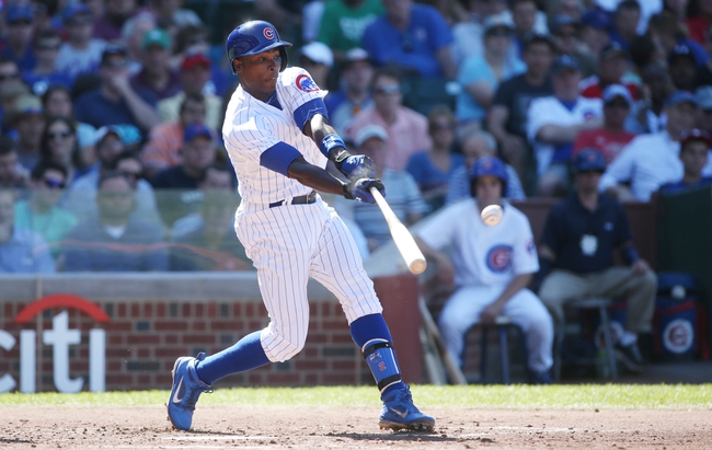 Jul 12, 2013; Chicago, IL, USA; Chicago Cubs left fielder Alfonso Soriano hits a RBI single against the St. Louis Cardinals during the third inning at Wrigley Field. Mandatory Credit: Jerry Lai-USA TODAY Sports