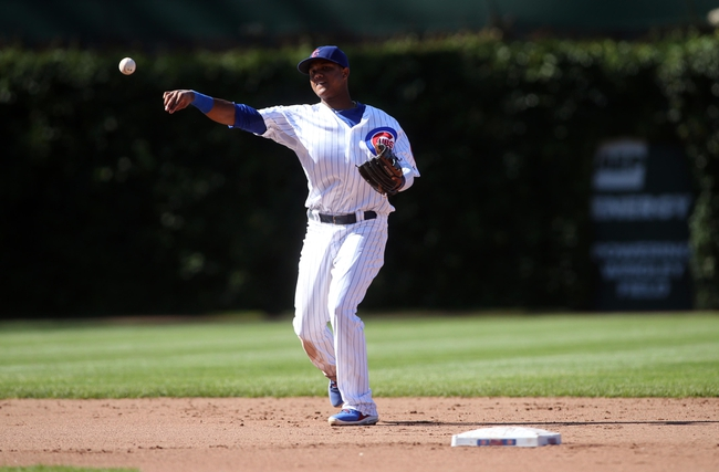 Jul 12, 2013; Chicago, IL, USA; Chicago Cubs shortstop Starlin Castro throws to first base during the fifth inning against the St. Louis Cardinals at Wrigley Field. Mandatory Credit: Jerry Lai-USA TODAY Sports