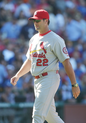Jul 12, 2013; Chicago, IL, USA; St. Louis Cardinals manager Mike Matheny walks back to the dugout after a pitching change during the sixth inning against the Chicago Cubs at Wrigley Field. Mandatory Credit: Jerry Lai-USA TODAY Sports