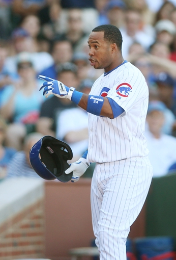 Jul 12, 2013; Chicago, IL, USA; Chicago Cubs third baseman Luis Valbuena reacts after striking out against the St. Louis Cardinals during the seventh inning at Wrigley Field. Mandatory Credit: Jerry Lai-USA TODAY Sports