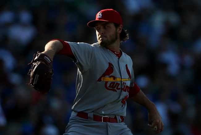Jul 12, 2013; Chicago, IL, USA; St. Louis Cardinals relief pitcher Kevin Siegrist throws a pitch against the Chicago Cubs during the eighth inning at Wrigley Field. Mandatory Credit: Jerry Lai-USA TODAY Sports