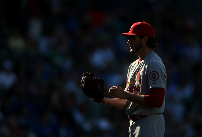 Jul 12, 2013; Chicago, IL, USA; St. Louis Cardinals relief pitcher Kevin Siegrist prepares to deliver a pitch against the Chicago Cubs during the eighth inning at Wrigley Field. Mandatory Credit: Jerry Lai-USA TODAY Sports