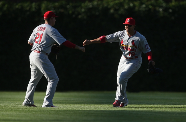 Jul 12, 2013; Chicago, IL, USA; St. Louis Cardinals outfielders Carlos Beltran (3) and Allen Craig (21) celebrate after the game against the Chicago Cubs at Wrigley Field. The Cardinals won 3-2. Mandatory Credit: Jerry Lai-USA TODAY Sports