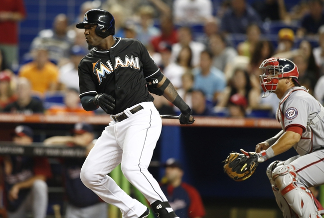 Jul 12, 2013; Miami, FL, USA;  Miami Marlins right fielder Marcell Ozuna (48) hits a bases loaded triple triple off Washington Nationals starting pitcher Stephen Strasburg (not pictured) in the first inning at Marlins Park.  Mandatory Credit: Robert Mayer-USA TODAY Sports