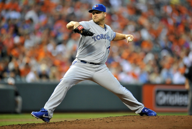 Jul 12, 2013; Baltimore, MD, USA; Toronto Blue Jays starting pitcher Mark Buehrle (56) throws in the second inning against the Toronto Blue Jays at Oriole Park at Camden Yards. Mandatory Credit: Joy R. Absalon-USA TODAY Sports