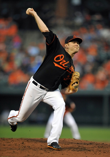 Jul 12, 2013; Baltimore, MD, USA; Baltimore Orioles pitcher Chris Tillman (30) throws in the third inning against the Toronto Blue Jays at Oriole Park at Camden Yards. Mandatory Credit: Joy R. Absalon-USA TODAY Sports
