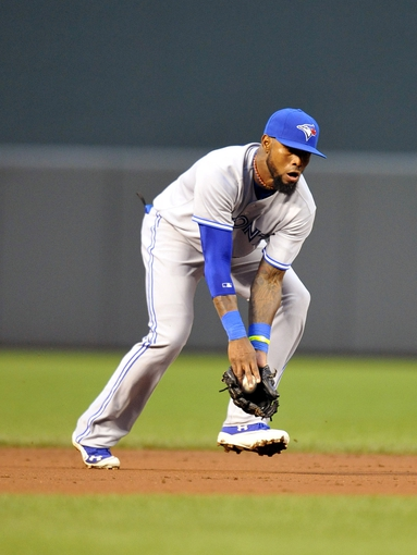 Jul 12, 2013; Baltimore, MD, USA; Toronto Blue Jays shortstop Jose Reyes (7) fields a ground ball hit by Baltimore Orioles second baseman Brian Roberts (not shown) in the third inning at Oriole Park at Camden Yards. Mandatory Credit: Joy R. Absalon-USA TODAY Sports