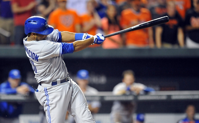 Jul 12, 2013; Baltimore, MD, USA; Toronto Blue Jays first baseman Edwin Encarnacion (10) singles in the ninth inning against the Baltimore Orioles at Oriole Park at Camden Yards. The Orioles defeated the Blue Jays 8-5. Mandatory Credit: Joy R. Absalon-USA TODAY Sports