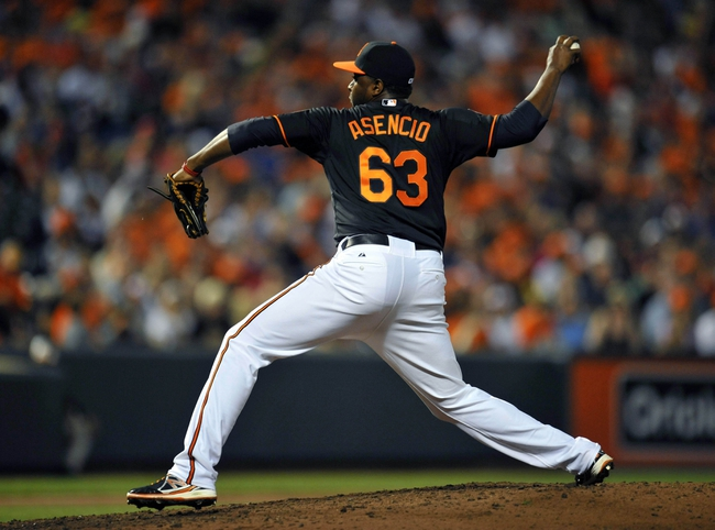 Jul 12, 2013; Baltimore, MD, USA; Baltimore Orioles pitcher Jairo Esencio (63) makes his Orioles debut pitching in the seventh inning against the Toronto Blue Jays at Oriole Park at Camden Yards. The Orioles defeated the Blue Jays 8-5. Mandatory Credit: Joy R. Absalon-USA TODAY Sports