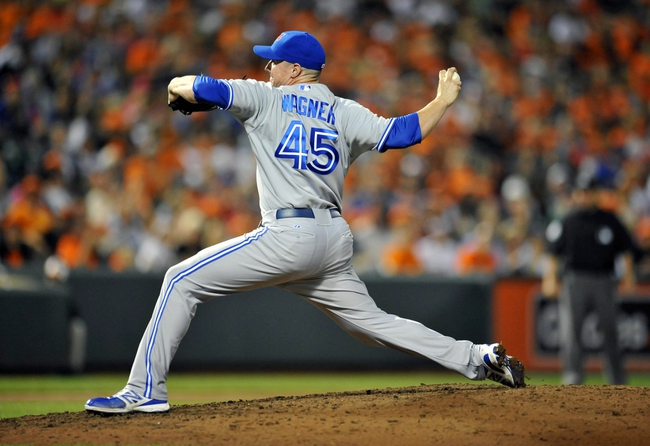 Jul 12, 2013; Baltimore, MD, USA; Toronto Blue Jays pitcher Neil Wagner (45) throws in the eighth inning against the Baltimore Orioles at Oriole Park at Camden Yards. The Orioles defeated the Blue Jays 8-5. Mandatory Credit: Joy R. Absalon-USA TODAY Sports