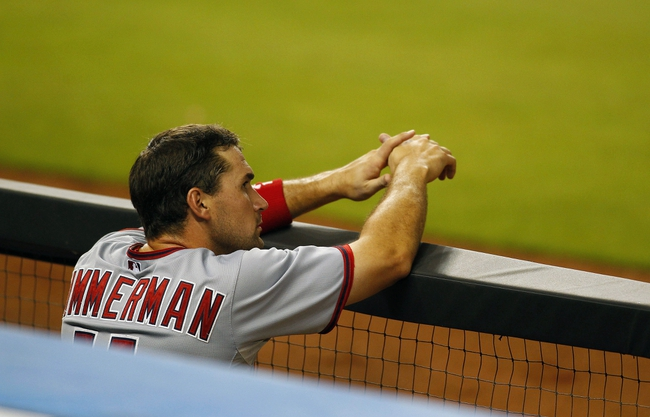 Jul 12, 2013; Miami, FL, USA;  Washington Nationals third baseman Ryan Zimmerman (11) reacts after popping out in the eighth inning against the Miami Marlins at Marlins Park.  Mandatory Credit: Robert Mayer-USA TODAY Sports