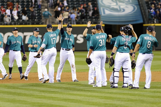 Jul 12, 2013; Seattle, WA, USA; The Seattle Mariners celebrate after defeating the Los Angeles Angels at Safeco Field. Seattle defeated Los Angeles 8-3. Mandatory Credit: Steven Bisig-USA TODAY Sports