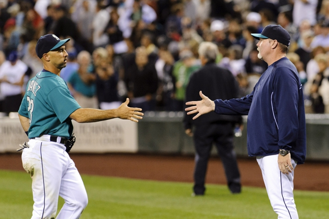 Jul 12, 2013; Seattle, WA, USA; Seattle Mariners left fielder Raul Ibanez (28) and manager Eric Wedge (22) shake hands after the game between the Seattle Mariners and the Los Angeles Angels at Safeco Field. Seattle defeated Los Angeles 8-3. Mandatory Credit: Steven Bisig-USA TODAY Sports