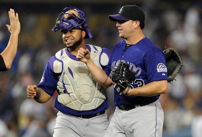 Jul 12, 2013; Los Angeles, CA, USA;  Colorado Rockies relief pitcher Rafael Betancourt (63) and catcher Wilin Rosario (20) after the game against the Los Angeles Dodgers at Dodger Stadium. Rockies won 3-0. Mandatory Credit: Jayne Kamin-Oncea-USA TODAY Sports