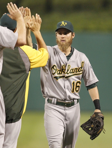 Jul 9, 2013; Pittsburgh, PA, USA; Oakland Athletics right fielder Josh Reddick (16) high-fives teammates after defeating the Pittsburgh Pirates at PNC Park. The Oakland Athletics won 2-1. Mandatory Credit: Charles LeClaire-USA TODAY Sports