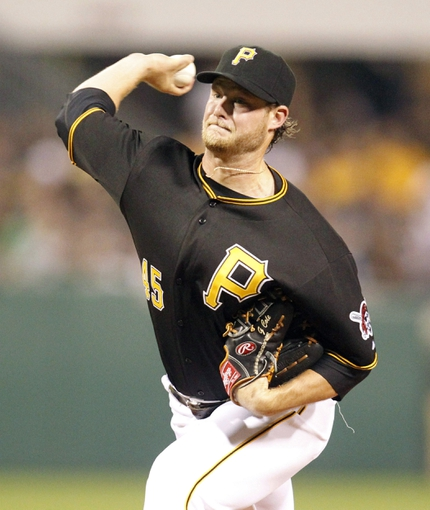 Jul 9, 2013; Pittsburgh, PA, USA; Pittsburgh Pirates starting pitcher Gerrit Cole (45) delivers a pitch against the Oakland Athletics during the fourth inning at PNC Park. The Oakland Athletics won 2-1. Mandatory Credit: Charles LeClaire-USA TODAY Sports