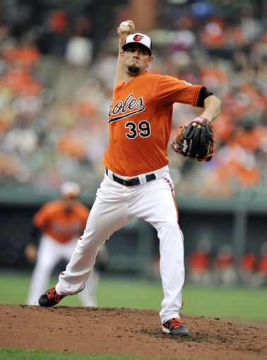 Jul 13, 2013; Baltimore, MD, USA; Baltimore Orioles starting pitcher Jason Hammel (39) throws in the third inning against the Toronto Blue Jays at Oriole Park at Camden Yards. Mandatory Credit: Joy R. Absalon-USA TODAY Sports
