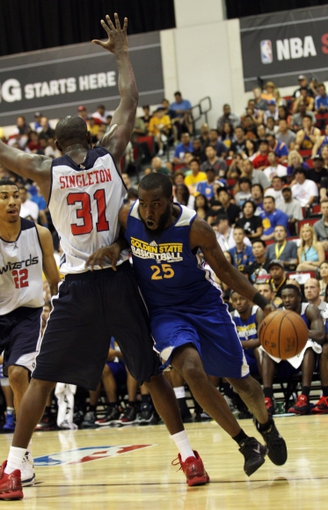 Jul 13, 2013; Las Vegas, NV, USA; Golden State Warriors forward Dwayne Davis drives past Washington Wizards forward Chris Singleton during the second quarter of Summer League play at the Cox Pavillion. Mandatory Credit: Stephen R. Sylvanie-USA TODAY Sports