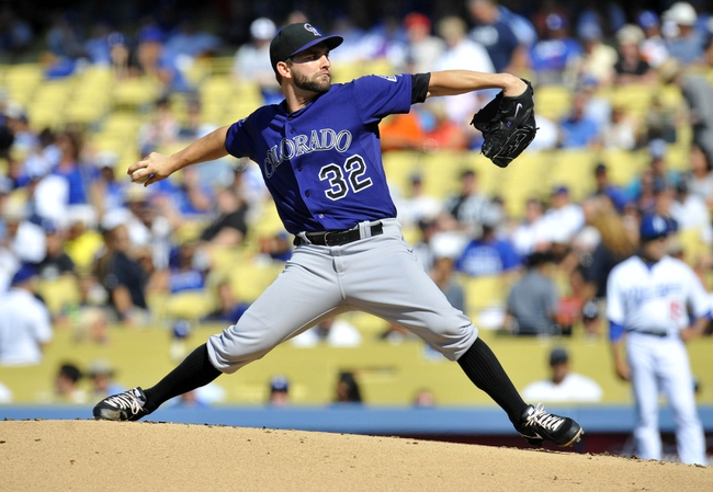 July 13, 2013; Los Angeles, CA, USA; Colorado Rockies starting pitcher Tyler Chatwood (32) pitches during the first inning against the Los Angeles Dodgers at Dodger Stadium. Mandatory Credit: Gary A. Vasquez-USA TODAY Sports