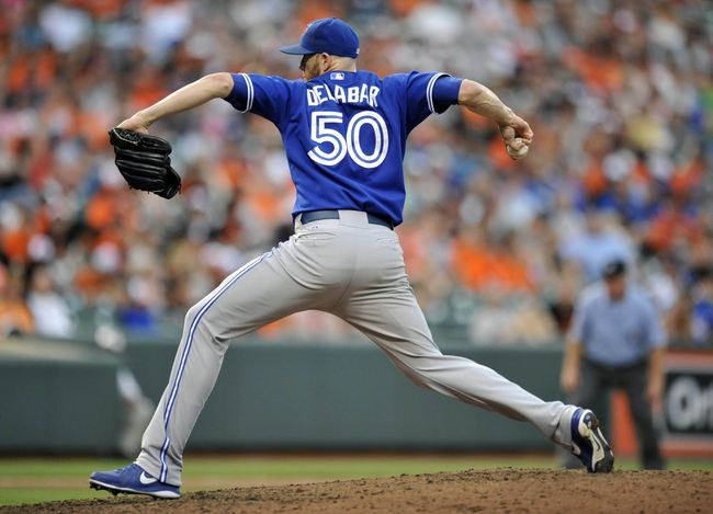 Jul 13, 2013; Baltimore, MD, USA; Toronto Blue Jays pitcher Steve Delabar (50) pitches in the ninth inning against the Baltimore Orioles at Oriole Park at Camden Yards. The Blue Jays defeated the Orioles 7-3. Mandatory Credit: Joy R. Absalon-USA TODAY Sports