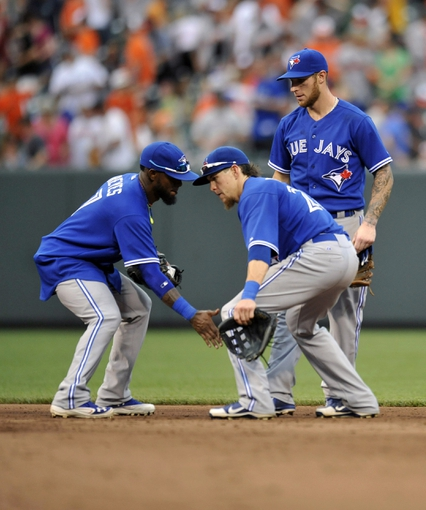Jul 13, 2013; Baltimore, MD, USA; Toronto Blue Jays shortstop Jose Reyes (7) and Colby Rasmus (28) celebrate after a game against the Baltimore Orioles at Oriole Park at Camden Yards. The Blue Jays defeated the Orioles 7-3. Mandatory Credit: Joy R. Absalon-USA TODAY Sports
