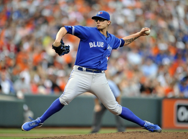 Jul 13, 2013; Baltimore, MD, USA; Toronto Blue Jays pitcher Brett Cecil (27) throws in the eighth inning against the Baltimore Orioles at Oriole Park at Camden Yards. The Blue Jays defeated the Orioles 7-3. Mandatory Credit: Joy R. Absalon-USA TODAY Sports