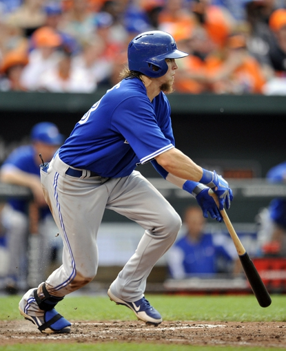 Jul 13, 2013; Baltimore, MD, USA; Toronto Blue Jays center fielder Colby Rasmus (28) hits a one-run RBI single in the seventh inning against the Baltimore Orioles at Oriole Park at Camden Yards. The Blue Jays defeated the Orioles 7-3. Mandatory Credit: Joy R. Absalon-USA TODAY Sports