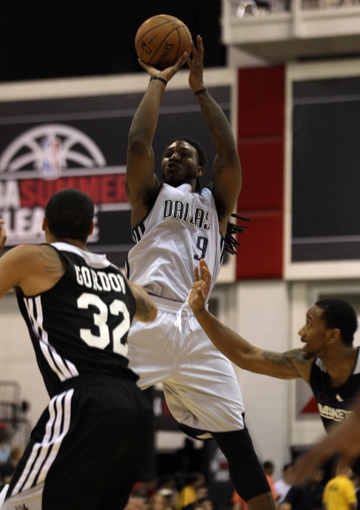 Jul 13, 2013; Las Vegas, NV, USA; Dallas Mavericks forward Jae Crowder eyes the basket during a jump shot attempt while being defended by Sacramento Kings forward Drew Gordon and guard David Lighty during the second half of an NBA Summer League game at Cox Pavillion. Mandatory Credit: Stephen R. Sylvanie-USA TODAY Sports